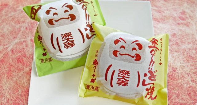 笑顔のだるまが描かれたパッケージ。パッケージの背景色は抹茶が黄緑、クリームは黄色。