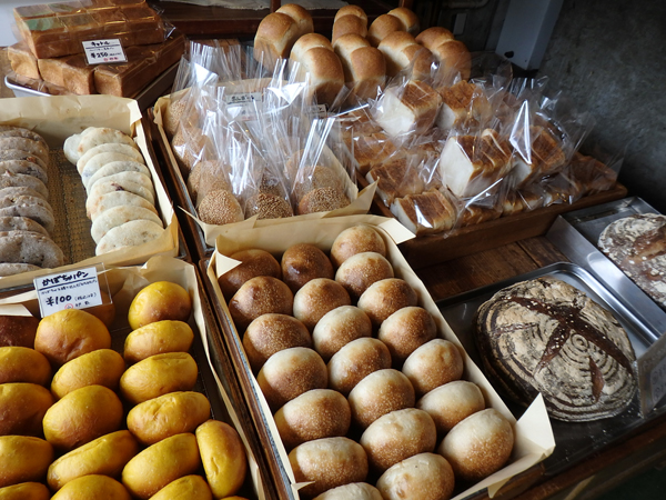 The shop's selection before it opens. A spread of freshly baked bread.
