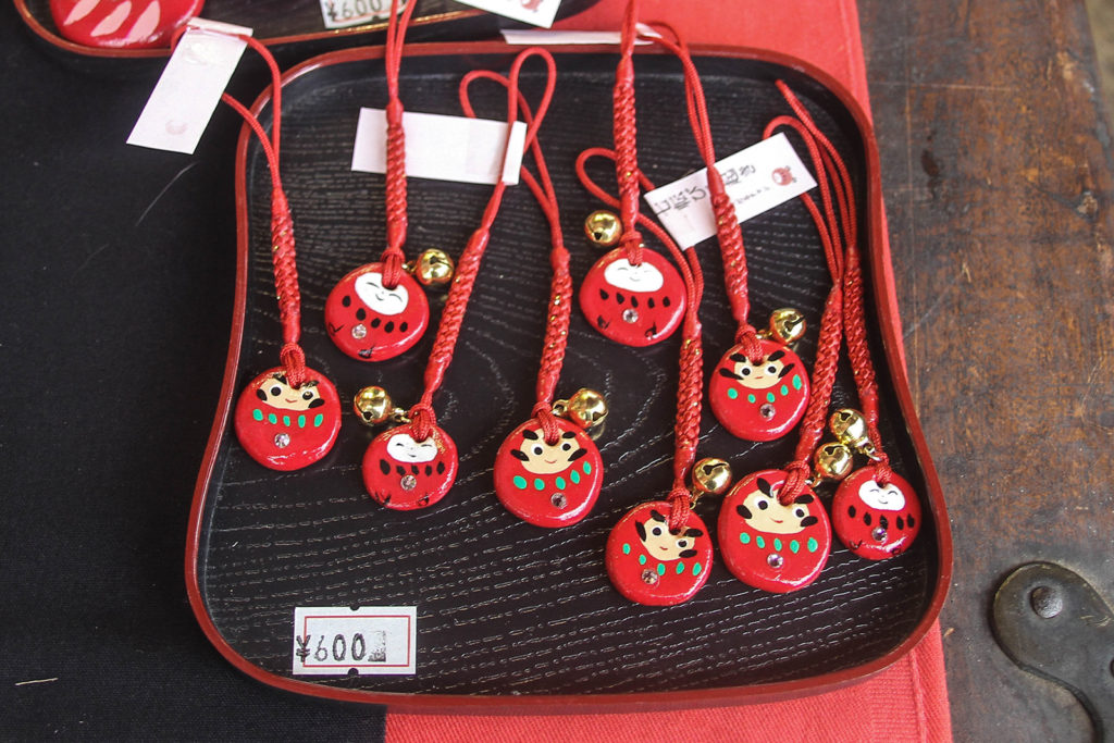 All decorations are hand-painted. Each daruma has a unique face.